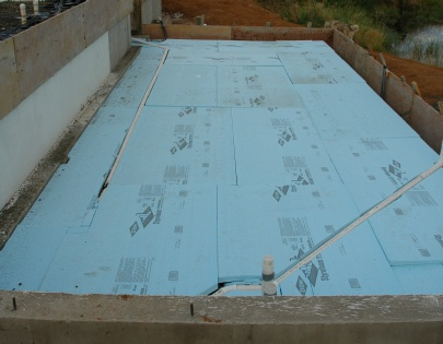 rigid insulation on top of compacted rock